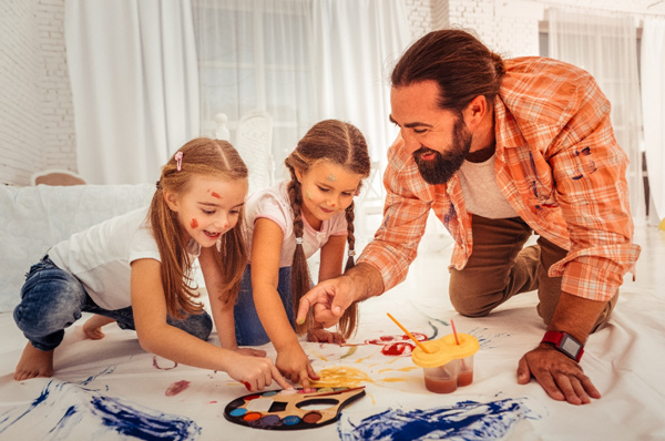 Father with girls painting